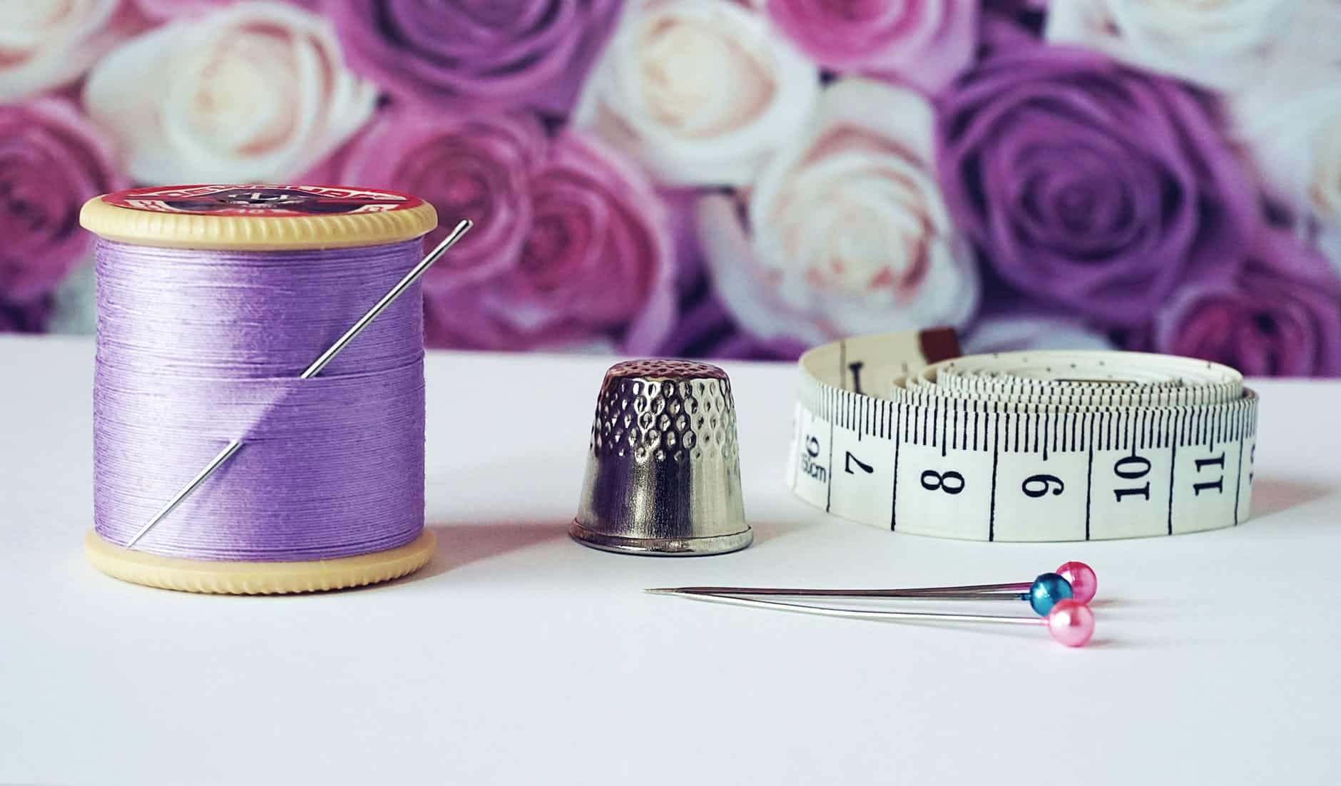 Measuring tape and purple thread
