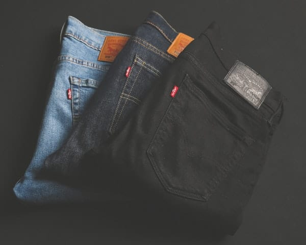 folded assorted jeans