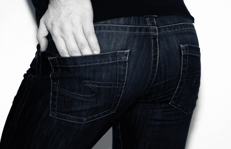 person hand in jeans pocket